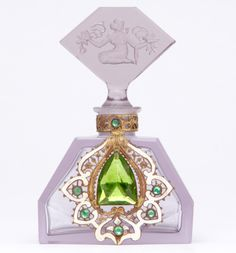 CZECH Perfume bottle in purple crystal with enamelled and jewelled metalwork, kneeling maiden stopper with dauber, 1920s. Stenciled line MADE IN CZECHOSLOVAKIA, metal tag CZECHOSLOVAKIA. 3 7/8""
