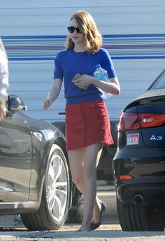 Eye-catching combination: Emma stood out in a royal blue sweater and bright red mini-shirt along with blue shoes as she emerged from her dressing room