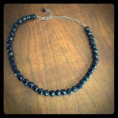 Black Faceted Bead Necklace Black plastic faceted beads with silvertone hardware.  Elastic. Jewelry Necklaces