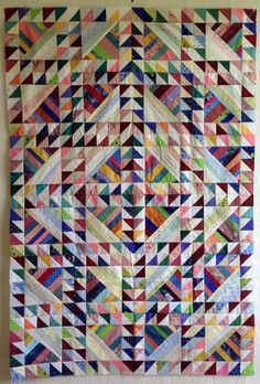 Scrap quilt, HST and strings, by Terry Kramzar