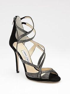 With her LBD, Nikki is wearing a pair of strappy sandals which are 'astounding' and are 'worth the pain'. Hey, we've all been there, right? These gorgeous Jimmy Choo Suede and Crystal Strappy Sandals would be worth it, we think...
