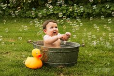 Cuteness overload! Baby boy with bubbles and giant rubber duckie, outdoor Chico, CA photography six month portrait session -- by Chico Bee Photography