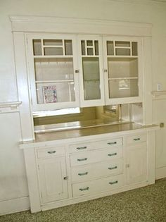 built in buffet with pass through space. (put glass on the kitchen side of cabinets in our version)