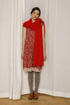 Beautiful red geometric print, but I think the patterned stockings are too much.