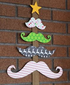 Did you ever notice that a mustache looks a little bit like a tree branch? Neither did we, but somehow this Mustache Christmas Tree Card Holder works. So quirky and cute!