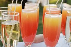 Champagne Hula - pineapple flavored rum, champagne, grand marnier, grenadine and pineapple juice - Yum!