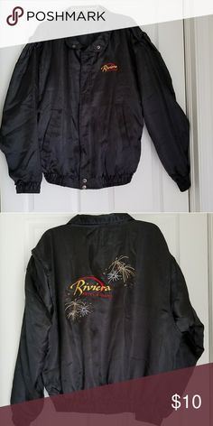 Mens jacket Black jacket logo on left side says Rivera Hotel & Casino back logo reads the same red gold and looks like fireworks around the logo in gold an  silver silky satin finish to the touch elastic on sleeves an on bottom of waist nice with jeans for your guy  lighting not good its very  black never worn Jackets & Coats Lightweight & Shirt Jackets