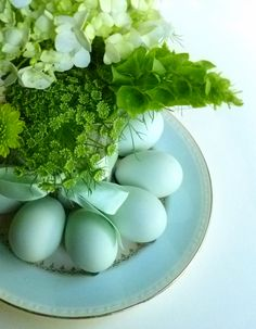 A lovely easter egg holder arrangement, complete with vase, with bent spoons to hold the eggs.