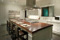 White Kitchen Cabinets With Calcutta Gold Marble Counter Tops Island Butcher Block Beveled Farmhouse Sink And Stove