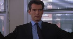 Pierce Brosnan most likely wearing his tie with a double-four-in-hand knot.