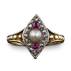 A shimmering natural button pearl is enveloped by tiny twinkling rose-cut diamonds and a pair of bright red rubies in this darling navette shape ring. Circa 1850.