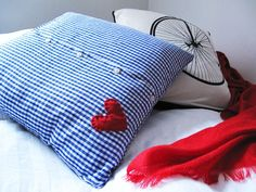 Button-Up Shirt Pillow...I've got a few of my boyfriend's old shirts that I feel bad parting with.  Here's my answer!