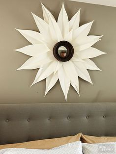 Poster board, a small mirror, and a hot glue gun are all you need for this simple sunburst mirror.