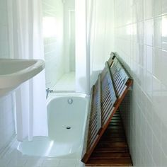 shower with hidden tub. So cool. I'm assuming the water goes through the floor of the shower into the tub to drain. How much would the wood hold tho? Good for a small bathroom I'm sure.