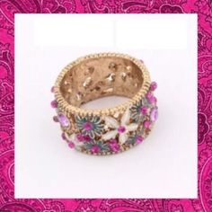 Floral Rhinestone Ring Beautiful & elegant gold tone ring with enamel & rhinestone flowers. Perfect for any occasion! New. No Trades. Size 7.  Price firm unless bundled. All sales final. Ask questions prior to purchasing. I want happy customers! Thanks for visiting & Happy Poshing! Boutique Jewelry Rings