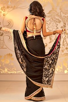 Shop online at http://www.satyapaul.com/satyapaul/shop/bridal-wear/bridal-sarees/black-georgette-with-net-insertion-and-kundan-border-saree   and visit us at http://www.facebook.com/SatyaPaulIndia
