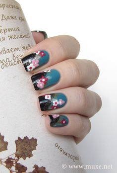 Amazing nails with random Cyrillic Writing in the background.