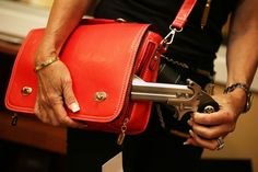 Susan Kushlin poses with a concealed-carry handbag that her company, Gun Girls, Inc., created for women that enjoy guns in Boca Raton, Flori...