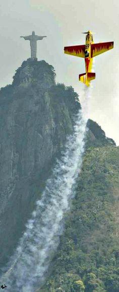 Plane ascends near Christ the Redeemer Statue in Rio de Janeiro, Brazil