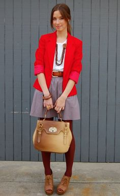 I love this unusual color combo!!!  Red + Maroon tights with subtle skirt