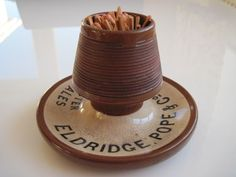 Match Striker & holder advertising Eldridge Pope Dorchester Ales. 8cm high. In excellent condition.