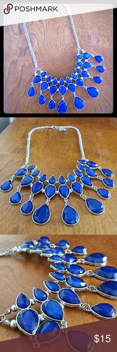Blue tear drop statement necklace. Beautiful deep blue statement necklace! Adjustable in length and in great condition. Jewelry Necklaces