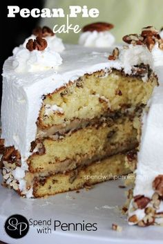 Pecan Pie Cake!  3 Layers of delicious pecan crusted cake with an amazing homemade filling and frosted with fresh whipped cream!