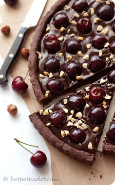 Chocolate Hazelnut Cherry Tart  Source: Adapted from Smitten Kitchen's Great Unshrinkable Sweet Tart Shell.    1 cup flour  1/4 cup cocoa powder  1/4 hazelnuts, blanched, toasted and ground fine  1/2 cup powdered sugar  1/4 tsp salt  1/2 cup + 1 tbsp unsalted butter, cold and cut into pieces  1 egg    8 ounces semisweet chocolate, chopped  3/4 cup heavy cream  2 tbsp unsalted butter