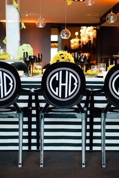 Monogrammed Louis-style bar stools; black and white striped counter