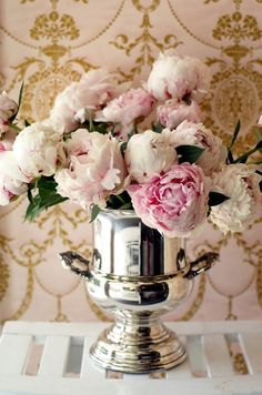 peonies in a classic silver vase