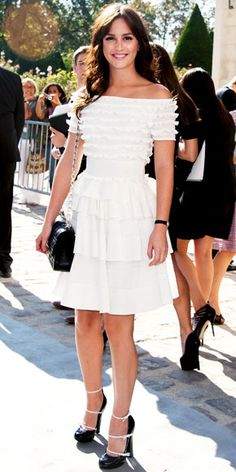 Leighton Meester arrived for the Christian Dior runway show in a tiered LWD, quilted purse and leather Louis Vuitton pumps.