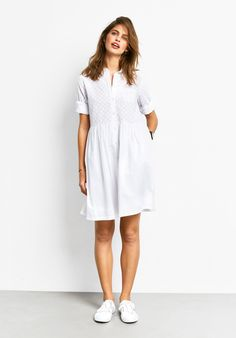 """Keep your cool in the Summer months in our light cotton shirt dress. The unique broderie anglaise star pattern adds a feminine touch. Just add lace-up pumps. •Easy, straight fit. Try your usual size. •Star broderie anglaise. •Button front closure. •Collared with button front & cuffs. •Sits on or above the knee depending on height. •Lightweight cotton. •Length 96cm (size 10). •Model is 5'9"""" and wea..."""