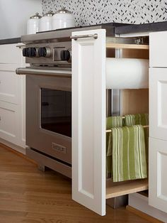 Pullout with towel rack for kitchen towels & paper towels.  Out of sight but within easy reach when needed.