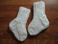 This is a quick and easy newborn sock pattern I wrote for charity knitting. The ribbing extends down the instep to help make a snug fit and to keep the socks on the feet. The heel to toe measurement is 3 inches.