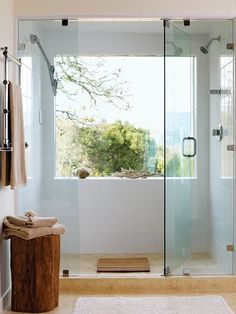 Love this huge window in the shower along with the frameless shower glass and the low step entry.