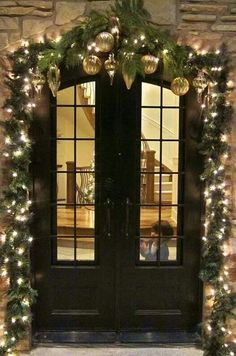 Gorgeous white lights cover the entrance, leading into a stairway also all decked out. Just lovely.