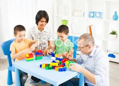 Mixed Race Family Playing with plastic blocks. Royalty Free Stock Photo