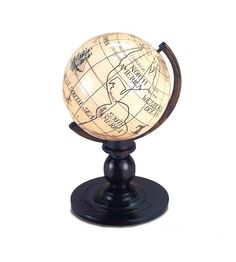 """Bone Globe on Ebonized Base    3 1/4"""" (8 cm.) 3 1/4""""h. An ebonized wooden pedestal with brass arc supports a ball-shaped bone or ivory globe with ink-painted cartographic details. Site names include Western Ocean,Siam,The Great Tartary,Chinese Empire,Greenland,The Great South Sea and South Congo,among more traditional names. Excellent condition. Circa 1880,a very rare dollhouse miniature."""