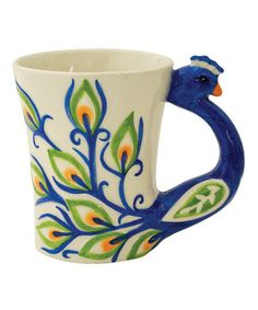 My long lost peacock mug from Ross was shaped like this, but with much more color and some gems.  If only I could find it