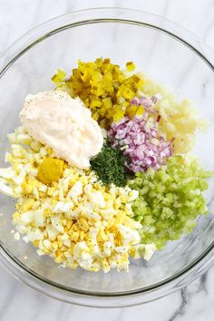 """A low-carb faux """"potato"""" salad made with cauliflower instead of potatoes, perfect for Keto or if you're just looking to eat less carbs."""