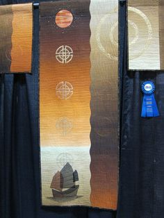 Seen at the Pacific International Quilt Festival in 2010. The more I look at this one, the more I like it. It's balanced, subtle, and satisfying.     IMG_2387 by quiltbaby, via Flickr