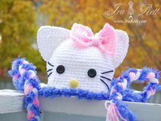 Handmade Crochet White Kitty Cat Hat with Bow inpsired by Hello Kitty for all ages.    This Hat will make a lovely gift or Photo prop.    Bow: Pink or Purple    Style: With or with glasses ( glasses can only be added to 1 yr or larger hats )    SIZE: Newborn, Baby, Infant, Toddler, Kids, Teen and Adult    $ 35.00 CAD
