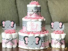 The Posh Toosh Specialty Diaper Cakes make perfect baby shower centerpieces and décor, baby shower gifts, nursery décor, and a unique and practical gift for a mommy-to-be! Set of 3 * 3 Tier with 2 Matching Mini Cakes- Pink and Gray Elephant Diaper Cakes Elephant Diaper Cakes, Elephant Baby Shower Cake, Grey Baby Shower, Baby Shower Diapers, Baby Boy Shower, Baby Shower Gifts, Elephant Party, Elephant Theme, Baby Shower Cupcakes