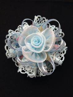 Hair bow made with lace and satin.