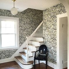 Petal Pusher wallpaper + Kartell chair + Schoolhouse Electric light = one fab stairway.