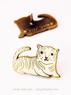 Check out this White Tiger Enamel Pin by boygirlparty: https://www.etsy.com/listing/248149615/white-tiger-enamel-pin-brass-pin-tiger