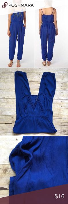 "Staring At Stars royal blue jumpsuit Blue gauzy jumpsuit with crochet front and pockets. Elastica waist and cuffs. Adjustable straps. In good preloved condition. 100% rayon. 53"" total length. 24"" inseam. 12.5"" drop inseam. 16.5"" bust laying flat. Size tags says medium, fits like a small and is listed as such. Please refer to measurements. Urban Outfitters Pants Jumpsuits & Rompers"