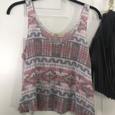 Tank top Tribal print, very slightly cropped, very thin sweater-like material but breathable for the summer. Worn roughly 5 times at the most. Elodie Tops Tank Tops