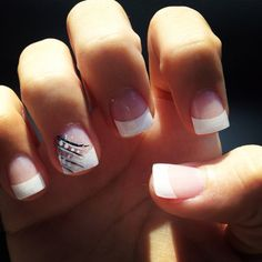 French tip acrylics with design on the ring finger -- the extra pink beds, length, shape