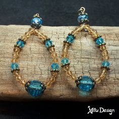 Blue and amber crystal dangle earrings by XetuDesign on Etsy Amber Crystal, Faceted Crystal, Crystal Earrings, Crystal Jewelry, Crystal Beads, Dangle Earrings, Crystals, Color Mixing, Turquoise Bracelet